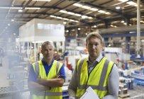 Portrait confident supervisors in steel factory — Stock Photo