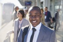Portrait smiling businessman on train station platform — Stock Photo