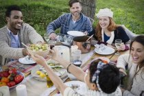 Friends eating lunch at patio table — Stock Photo