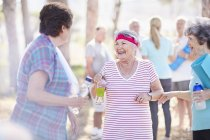 Senior women talking after yoga class in park — Stock Photo