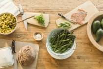 Overhead view lox, asparagus, pasta, bread and butter on dining table — Stock Photo