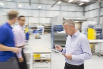 Manager with clipboard in steel industry — Stock Photo