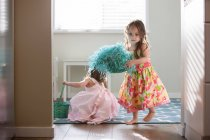 Girls in dresses with Easter baskets — Stock Photo