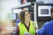 Smiling supervisor and worker at control panel in steel factory — Stock Photo