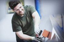 Worker sanding steel in steel factory — Stock Photo