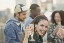 Portrait enthusiastic young woman drinking champagne at party — Stock Photo