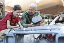 Father and son rebuilding car engine — Stock Photo