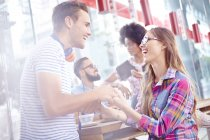 Couple laughing and holding hands in cafe — Stock Photo