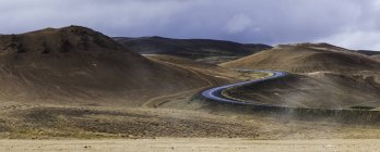Winding road surrounded by hills  during daytime — Stock Photo