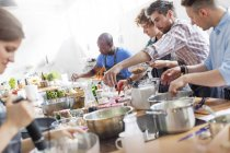Male students in cooking class kitchen — Stock Photo