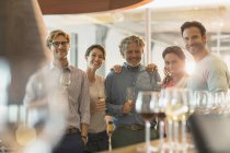 Portrait smiling friends wine tasting at winery — Stock Photo