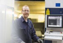 Portrait confident worker at control panel in steel factory — Stock Photo