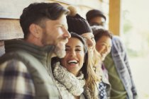Friends laughing outside cabin — Stockfoto