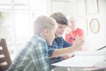 Boys drawing together at table in home — Stock Photo