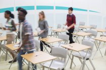 Students going out of classroom after lesson — Stock Photo