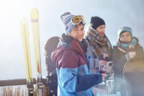 Portrait smiling female skier drinking cocktail on balcony with friends apres-ski — Stock Photo