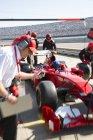 Manager con cronometro tempo formula uno pit crew sessione di prove — Foto stock
