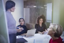 Businesswomen planning, talking in conference room meeting — Stock Photo