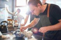 Focused male coffee roaster testing coffee — Stock Photo