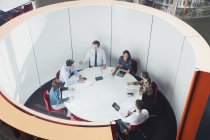 Business people meeting in round open plan conference room — Stock Photo