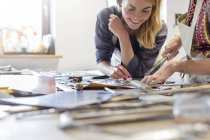 Stained glass artists working in studio — Stock Photo