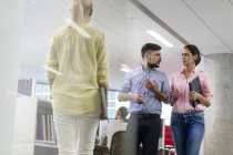 Business people talking and walking in office — Stock Photo