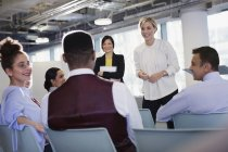 Businesswoman leading conference presentation, answering audience questions — Stock Photo