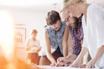Design professionals reviewing proofs in office — Stockfoto