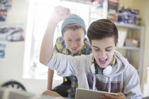 Two teenage boys having fun while using digital tablet — Stock Photo