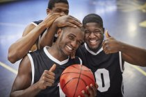 Portrait smiling, confident young male basketball player team celebrating, gesturing thumbs-up — Stock Photo