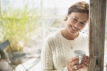Portrait smiling mature woman drinking coffee — Stock Photo