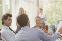 Business people talking in meeting together — Stockfoto