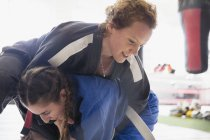 Women practicing judo in gym together — Stock Photo