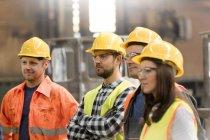 Steel workers portrait in meeting in factory — Stock Photo
