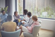 Women talking in group therapy session — Stock Photo