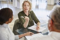 Businesswoman talking in meeting at modern office — Stock Photo