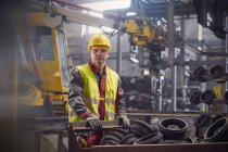 Portrait serious, confident steelworker in steel mill — Stock Photo