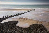 Remote ocean beach with craggy jetty, Heysham, Lancs, UK — Stock Photo
