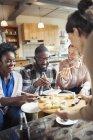 Friends eating sushi indoors — Stock Photo