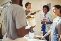Friends painting living room — Stock Photo