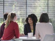 Businesswomen talking, planning at table in meeting — Stockfoto
