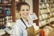 Portrait smiling, confident female worker in grocery store — Stock Photo