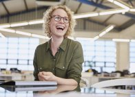 Laughing caucasian businesswoman at modern office — Stock Photo