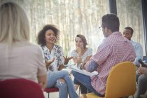 Woman talking in group therapy session — Stock Photo