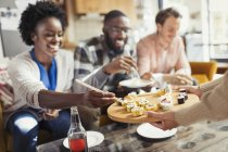 Friends eating sushi in living room — Stock Photo