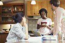 Friend roommates talking in kitchen — Stock Photo