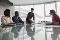 Businessman leading conference room meeting — Stock Photo