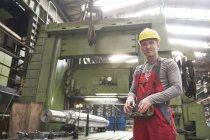 Portrait confident male worker working in steel factory — Stock Photo