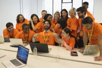 Portrait confident hackers coding for charity at hackathon — Stock Photo