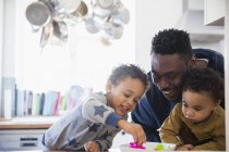 African american father playing with kids at home — Stock Photo